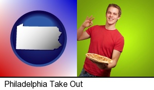 Philadelphia, Pennsylvania - a happy teenager holding a take-out pizza