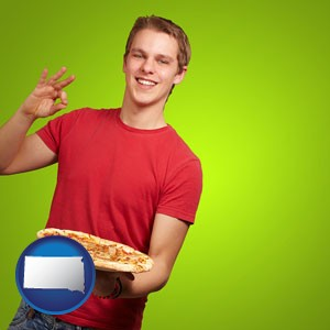 a happy teenager holding a take-out pizza - with South Dakota icon