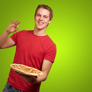 a happy teenager holding a take-out pizza